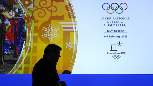 A member of the International Olympic Committee walks past a display during the 132nd IOC Session prior to the 2018 Winter Olympics in Pyeongchang, South Korea, Wednesday, Feb. 7, 2018 - Sputnik International