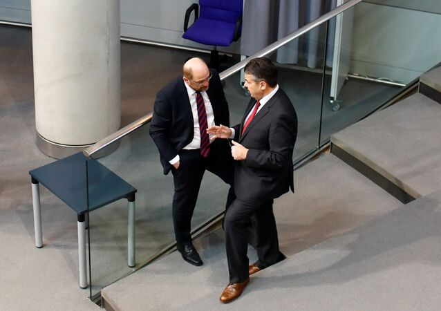 German Foreign Minister Sigmar Gabriel and Germany's Social Democratic Party SPD leader Martin Schulz talk during a session of the German lower house of Parliament, Bundestag, in Berlin, Germany, February 1, 2018