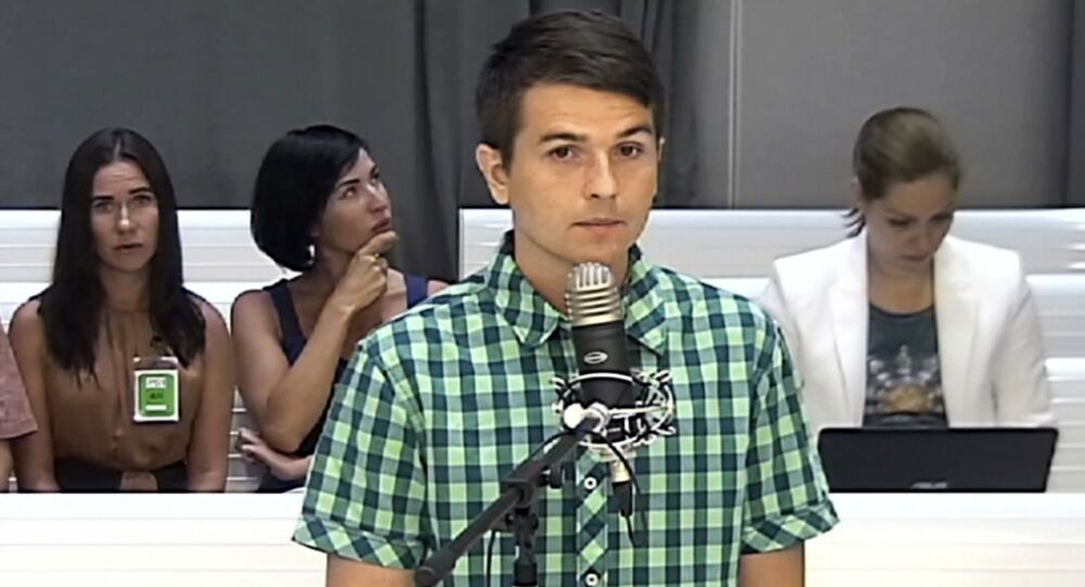 In this screen grab taken from video on Thursday, July 20, 2017, Russian computer programmer Stanislav Lisov attends a court hearing at the Spanish National Court in Madrid, on extradition request to the U.S. for alleged crimes related to the 'NeverQuest' malicious software, which syphoned 855,000 U.S. dollars (743,000 euros) from bank clients in the country