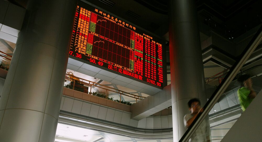 A panel displaying share prices is seen inside the Shenzhen Stock Exchange in the southern Chinese city of Shenzhen (File)