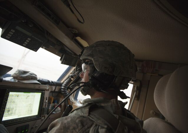 In Dec. 16, 2011 photo, Sergeant Daniel Martin watches the road and a GPS device inside his unit's Mine Resistant Ambush Protected vehicle during the US military's last combat patrol in Iraq