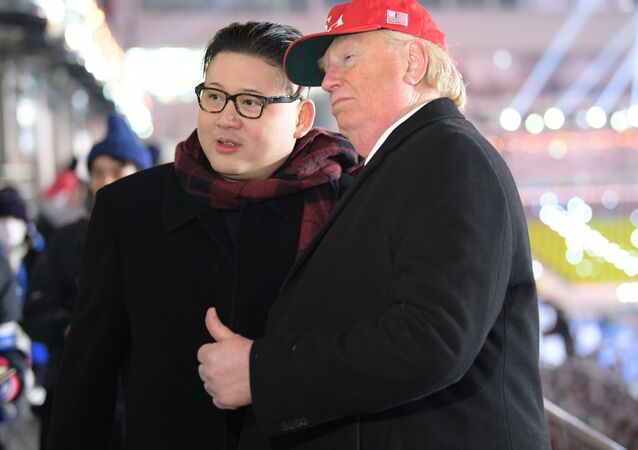 A man impersonating US President Donald Trump (R) and another impersonating Kim Jong-un pose in the stands during the opening ceremony of the Pyeongchang 2018 Winter Olympic Games at the Pyeongchang Stadium