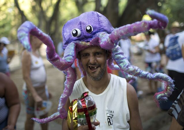 A patient from the Nise da Silveira Mental Health Institute wears an octopus costume during the institute's carnival parade, coined in Portuguese: Loucura Suburbana, or Suburban Madness, in the streets of Rio de Janeiro, Brazil, Thursday, Feb. 23, 2017