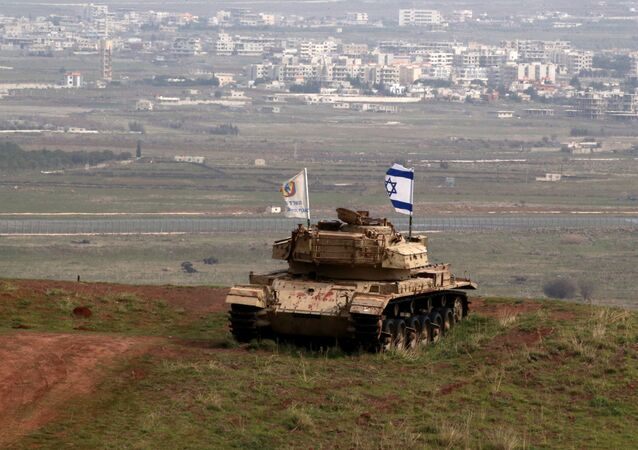An old military vehicle can be seen positioned on the Israeli side of the border with Syria, near the Druze village of Majdal Shams in the Israeli-occupied Golan Heights, Israel February 11, 2018