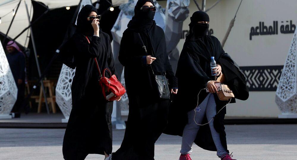 People walk during King Abdulaziz Camel Festival in Rimah Governorate, north-east of Riyadh, Saudi Arabia January 19, 2018.