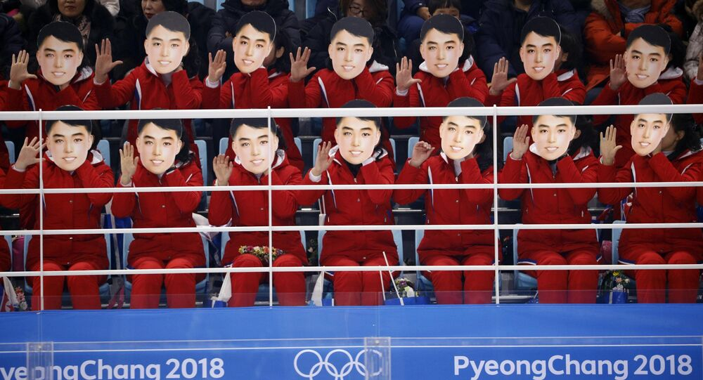 Ice Hockey – Pyeongchang 2018 Winter Olympics – Women Preliminary Round Match - Switzerland v Korea - Kwandong Hockey Centre, Gangneung, South Korea – February 10, 2018 - North Korea's cheer squad hold masks