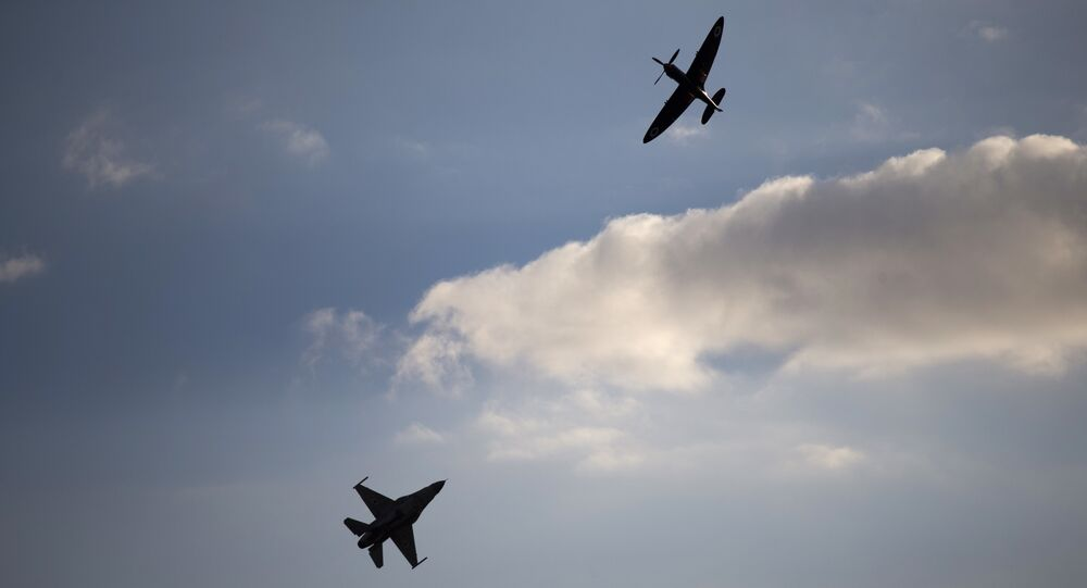 An Israeli Air Force F-16 plane, bottom, and an Israeli Air force Spitfire plane perform during a graduation ceremony for new pilots in the Hatzerim air force base near the city of Beersheba, Israel. (File)
