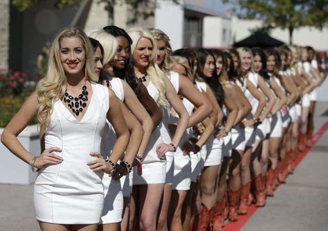 The Formula One Grid Girls pose after qualifications for the Formula One U.S. Grand Prix auto race at the Circuit of the Americas, Saturday, Nov. 1, 2014, in Austin, Texas. (File)