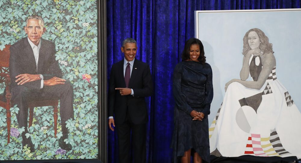 Former US President Barack Obama and former first lady Michelle Obama stand with their portraits during an unveiling ceremony at the Smithsonian's National Portrait Gallery in Washington, US, February 12, 2018.