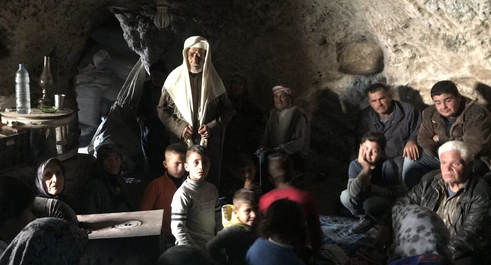 Residents of the Kurdish township of Jenderes in Afrin region in the north of Syria who fled from shellings by the Turkish Army are hiding in the caves in Haltan village