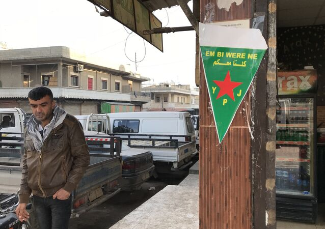 Flag of the Kurdish YPJ self-defense forces on the central street of the Syrian city of Afrin.