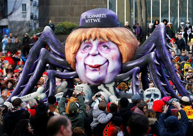 A carnival float shows Christian Democratic Union (CDU) leader and German Chancellor Angela Merkel as black widow at the traditional Rosenmontag Rose Monday carnival parade in Duesseldorf, Germany, February 12, 2018
