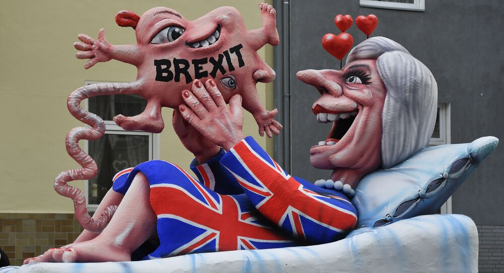 A float depicts British Prime Minister Theresa May looking at her Brexit-baby during the traditional Rose Monday parade in Duesseldorf, Germany