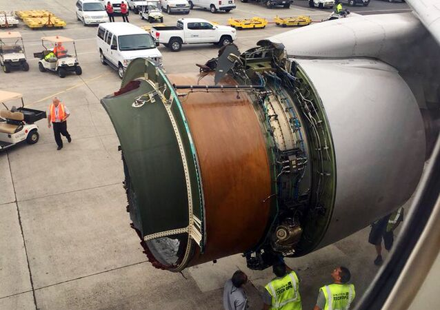This photo provided by passenger Haley Ebert shows damage to an engine on what the FAA says is a Boeing 777 after parts came off the jetliner during its flight from San Francisco to Honolulu Tuesday, Feb. 13, 2018