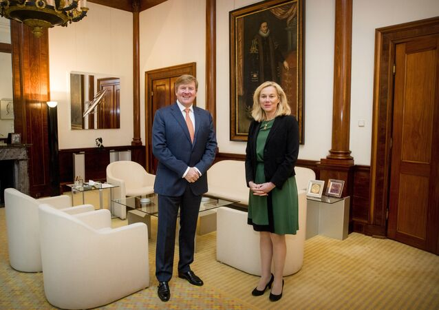 King Willem-Alexander of The Netherlands (L) poses with Dutch Minister of Foreign Trade and Development Cooperation Sigrid Kaag at the Royal Palace Noordeinde in The Hague on January 30, 2018