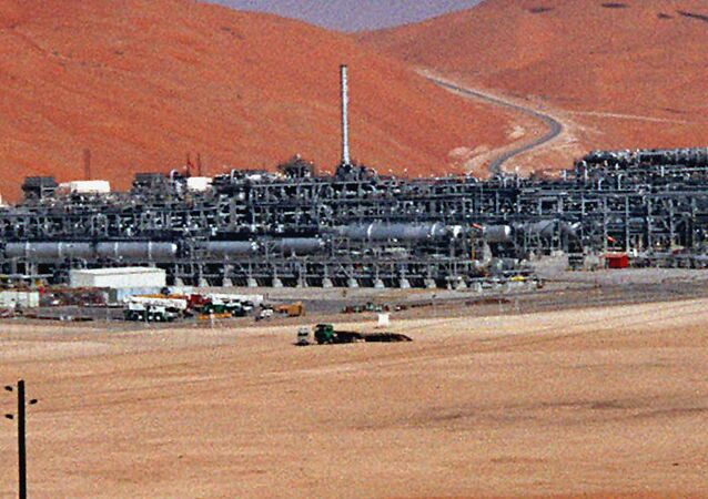 In this Monday, March 8, 2004 file photo, an industrial plant strips natural gas from freshly pumped crude oil is seen at Saudi Aramco's Shaybah oil field at Shaybah in Saudi Arabia's Rub al-Khali desert