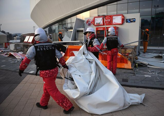 Volunteers during evacuation from the press center in the Gangneung Olympic Park due to strong winds