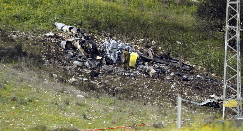 A picture taken in the northern Israeli Kibbutz of Harduf on February 10, 2018, shows the remains of an Israel F-16 that crashed after coming under fire by Syrian air defences during attacks against Iranian targets in the war-torn country