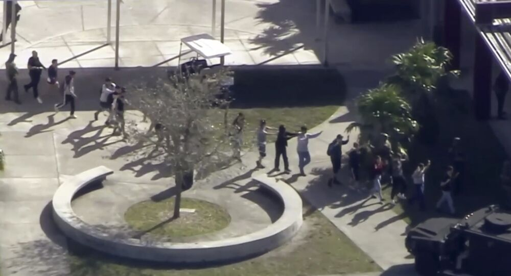 In this frame grab from video provided by WPLG-TV, students from the Marjory Stoneman Douglas High School in Parkland, Fla., evacuate the school following a shooting there on Wednesday, Feb. 14, 2018.