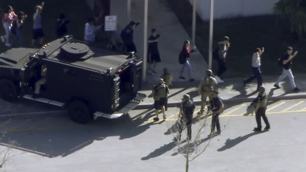 In this frame grab from video provided by WPLG-TV, students from the Marjory Stoneman Douglas High School in Parkland, Fla., evacuate the school following a shooting, Wednesday, Feb. 14, 2018. - Sputnik International