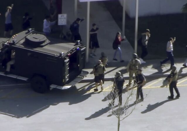 In this frame grab from video provided by WPLG-TV, students from the Marjory Stoneman Douglas High School in Parkland, Fla., evacuate the school following a shooting, Wednesday, Feb. 14, 2018.