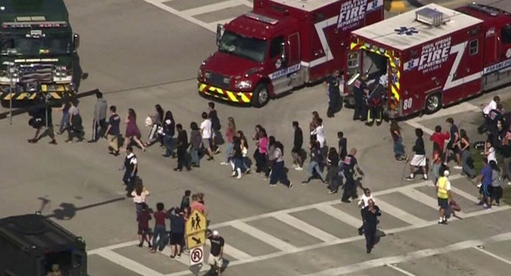 Students are evacuated from Marjory Stoneman Douglas High School during a shooting incident in Parkland, Florida, U.S. February 14, 2018 in a still image from video
