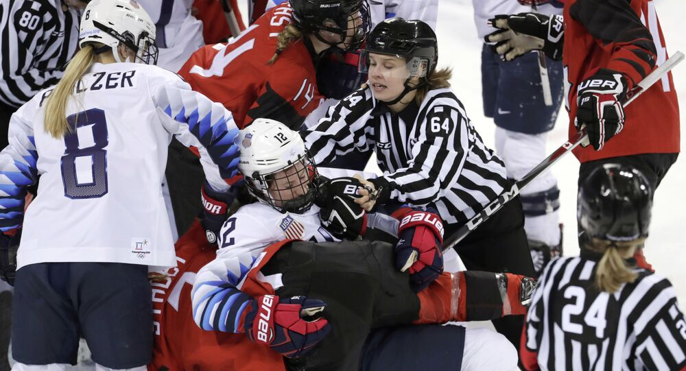 Official Jenni Heikkinen (64), of Finland, tries to separate Kelly Pannek (12), of the United States, and Laura Stacey (7), of Canada, as they scuffle during the third period of a preliminary round during a women's hockey game at the 2018 Winter Olympics in Gangneung, South Korea, Thursday, Feb. 15, 2018