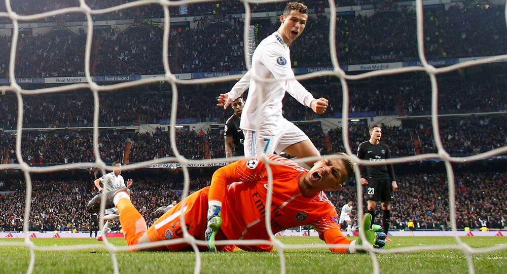 Soccer Football - Champions League Round of 16 First Leg - Real Madrid vs Paris St Germain - Santiago Bernabeu, Madrid, Spain - February 14, 2018 Real Madrid's Cristiano Ronaldo celebrates after Marcelo scores their third goal as Paris Saint-Germain's Alphonse Areola looks dejected