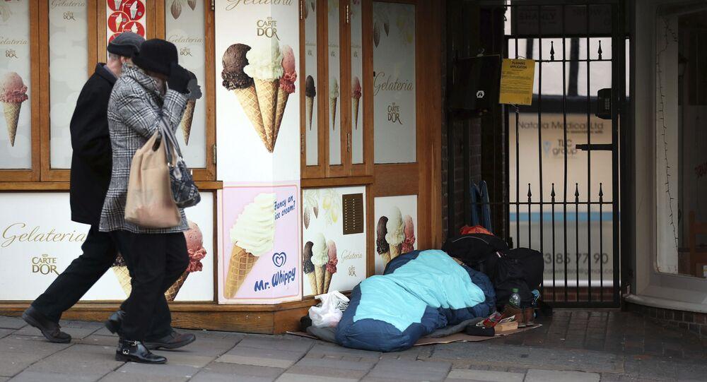 A homeless person sleeps rough near Windsor Castle in Windsor, England