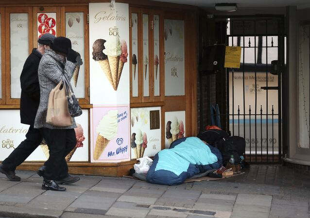 A homeless person sleeps rough near Windsor Castle in Windsor, England