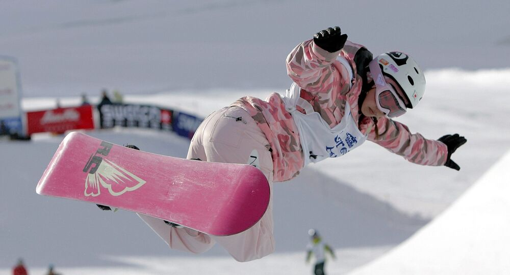 (File) Imai Melo of Japan in action during the women's Half-Pipe final at the FIS snowboard Freestyle World Cup 2005 in Saas-Fee, Switzerland, Friday, Oct. 21, 2005. Imai won the event