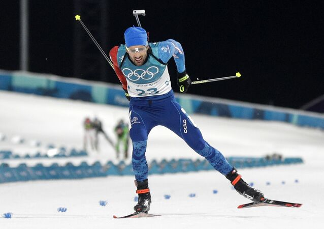 Martin Fourcade, of France, skis across the finish line during the men's 20-kilometer individual biathlon at the 2018 Winter Olympics in Pyeongchang, South Korea