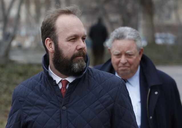 Rick Gates, left, with his lawyer Tom Green, depart Federal District Court, Wednesday, Feb. 14, 2018, in Washington