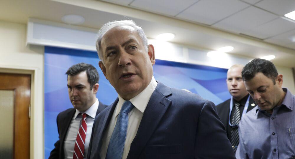 Israeli Prime Minister Benjamin Netanyahu arrives for a cabinet meeting in Jerusalem, Wednesday, Jan. 3, 2018