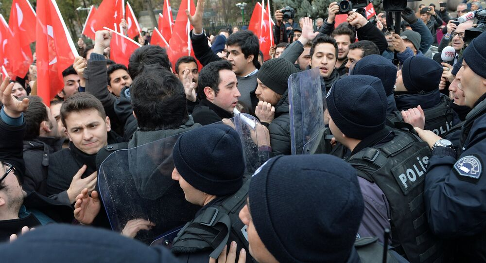 Members of a marginal nationalist party scuffle with riot police as they demonstrate in front of a venue where U.S. Secretary of State Rex Tillerson and Turkish Foreign Minister Mevlut Cavusoglu will hold a news conference in Ankara, Turkey, February 16, 2018