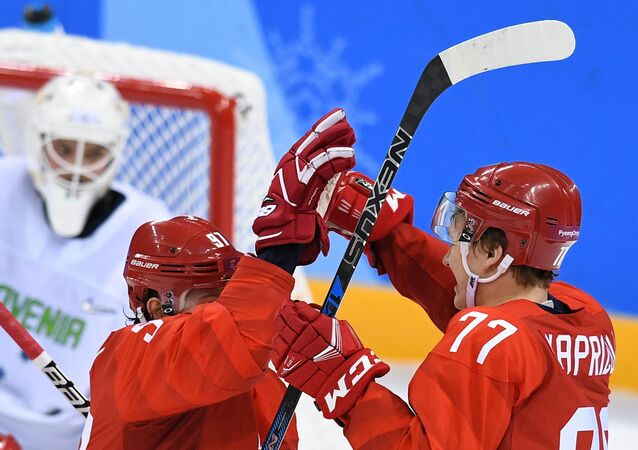From left: Nikita Gusev (Russia) and Kirill Kaprizov (Russia) celebrate a goal during a group stage match between Russia and Slovenia in the men's ice hockey tournament, at the XXIII Olympic Winter Games in Pyeongchang