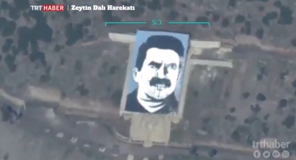 Turkish UAV destroys PKK leader portrait in Afrin