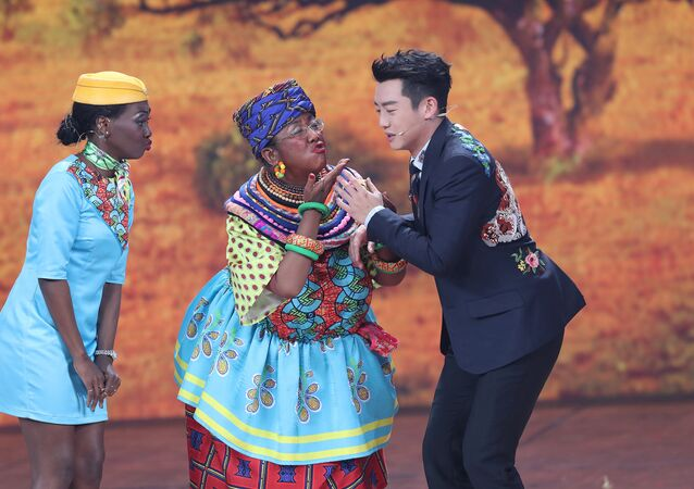 Chinese actor Lou Naiming (C) performs a skit on a Lunar New Year gala in Beijing, China, February 15, 2018