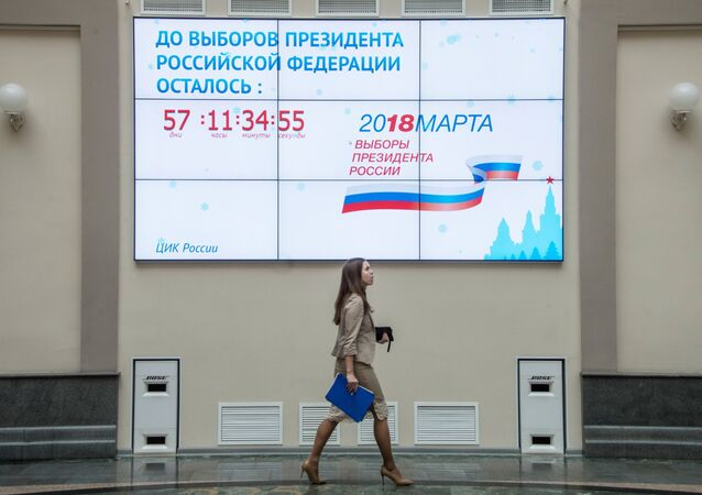 A screen with a countdown clock for the 2018 Russian presidential election on the building of the Central Electoral Commission in Moscow