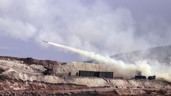 Turkish artillery fires toward Syrian Kurdish positions in Afrin area, Syria, from Turkish side of the border in Hatay, Turkey, Friday, Feb. 9, 2018 - Sputnik International