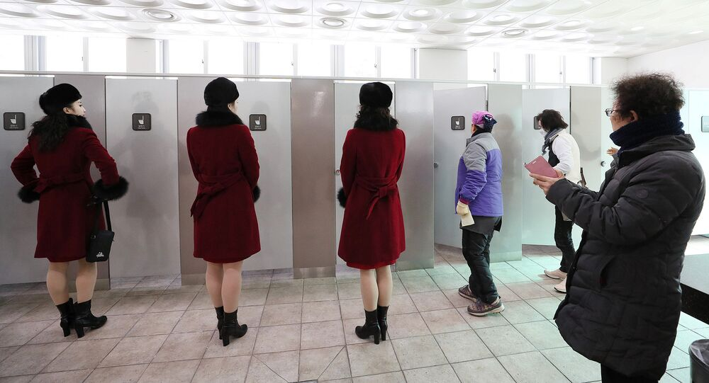 Members of North Korean cheering squad wait to use a toilet at a ladies' room at an expressway service area in Gapyeong, South Korea, February 7, 2018