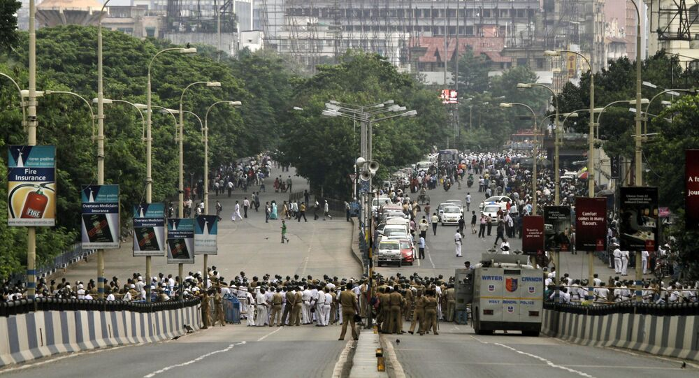 Indian policemen create a barricade at the end of an over bridge leading to the U.S. Consulate anticipating a protest against Innocence of Muslims, a film made in the U.S. that ridicules Islam's Prophet Muhammad in Kolkata, India, Thursday, Oct. 4, 2012