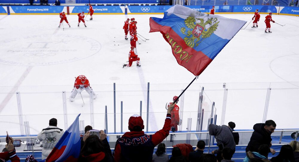 A Russian fan waves a flag before the ice hockey game between teams of Russia and the US at the 2018 Winter Olympics, February 17, 2018