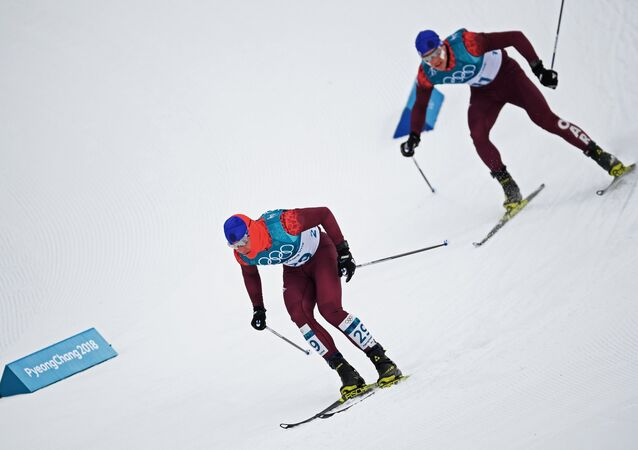 Russian athletes Andrei Melnichenko, left, and Andrei Larkov during the skiathlon event in men's cross-country skiing at the 2018 Winter Olympics in Pyeongchang.