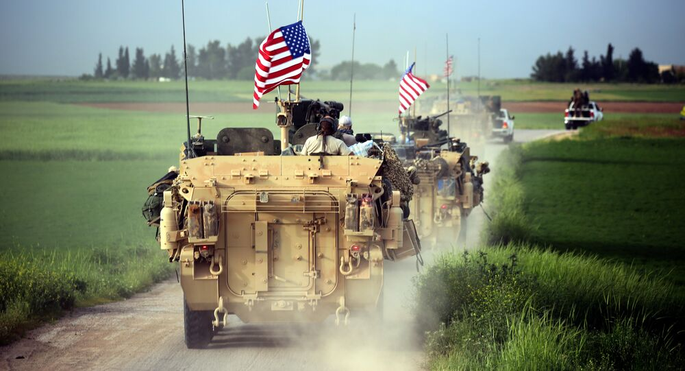 US forces, accompanied by Kurdish People's Protection Units (YPG) fighters, drive their armoured vehicles near the northern Syrian village of Darbasiyah, on the border with Turkey on April 28, 2017