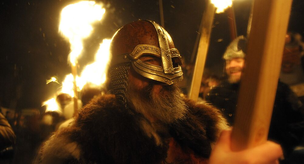 Participants dressed as Vikings carry torches as they march in processing beofre burning their viking galley ship at the culmination of the annual Up Helly Aa festival in Lerwick, Shetland Islands, on January 31, 2017