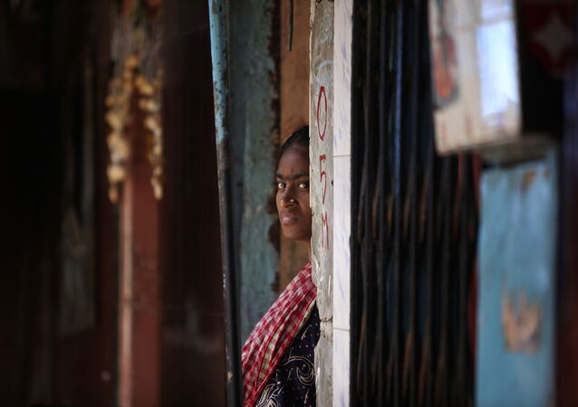 An Indian sex worker looks on outside her house at the Kamathipura red-light district, in Mumbai, India, Monday (File)