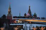 People visit Zaryadye Nature-Landscape Park in Moscow, Russia. Background from left: Spasskaya (Savior) Tower of the Moscow Kremlin and domes of Intercession of the Most Holy Theotokos on the Moat Cathedral (St. Basil's Cathedral)