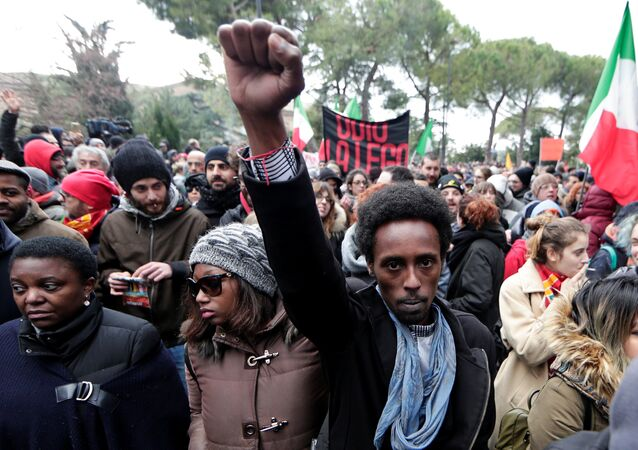 Demonstrators march during an anti-racism rally in Macerata, Italy, February 10, 2018
