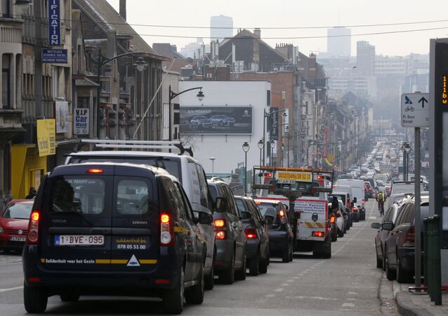 Stranded vehicles stand on a blocked street in Brussels as public transports are on strike following a call of several unions (CGSP-ACOD and CGSLB-ACLVB)